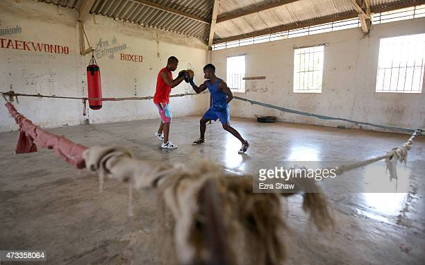 Ray Uamlet Quijano Font works out with his coach at the Mayabeque Boxing Acadmey on May 12 2015 in Hershey Cuba Mayabeque is the closest province to...