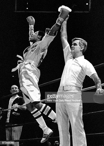 Ray Velez leaps for joy after being declared champion of the novice division at the 59th annual Daily News Golden Gloves finals