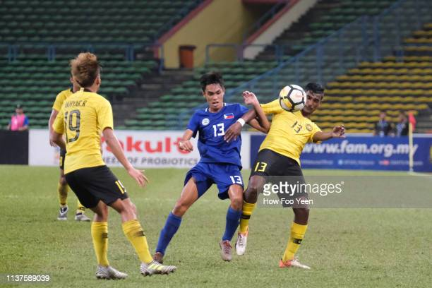 Ray Vincent Su Sancianggo of the Phillipines and Dinesh Rajasingam tussles for the ball during the AFC U23 Championship qualifier between Malaysia...
