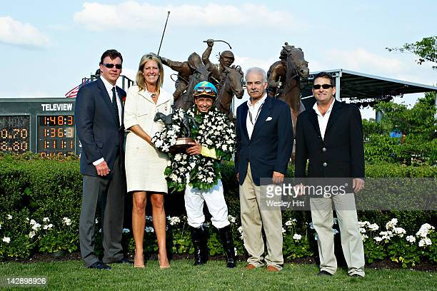 Ray White Harriet Cella Marshall Jockey Mike Smith Bill Baffert and Jimmy Barnes in the winners circle after riding Bodemeister to win the Arkansas...