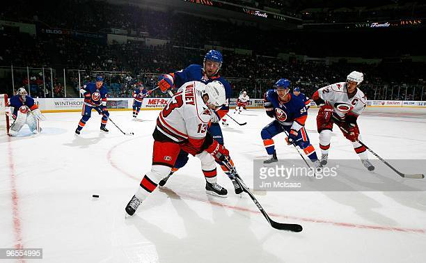 Ray Whitney and Eric Staal of the Carolina Hurricanes skate against the New York Islanders on February 6, 2010 at Nassau Coliseum in Uniondale, New...