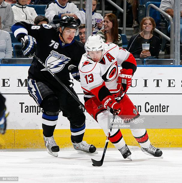 Ray Whitney of the Carolina Hurricanes controls the puck against Evgeny Artyukhin of the Tampa Bay Lightning during the first period at the St Pete...