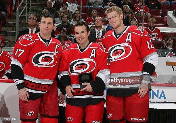 Ray Whitney of the Carolina Hurricanes is congratulated by teammates Rod Brind'Amour and Eric Staal during a pre-game ceremony at a game against the...