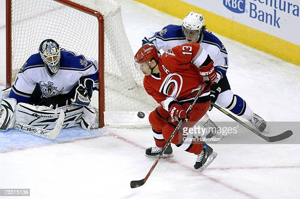 Ray Whitney of the Carolina Hurricanes shoots against Anze Kopitar and Sean Burke of the Los Angeles Kings in the second period on February 13, 2007...