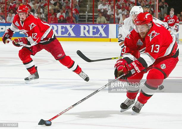 Ray Whitney of the Carolina Hurricanes skates with the puck alongside Eric Staal during game two of the 2006 NHL Stanley Cup Finals against the...