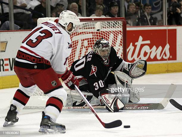 Ray Whitney of the Carolina Hurricanes tries to beat Sabres' goalie Ryan Miller during game 4 of the Eastern Conference Finals versus the Buffalo...