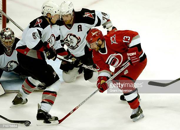 Ray Whitney of the Carolina Hurricanes tries to get past the Buffalo sabres defense in game five of the Eastern Conference Finals in the 2006 NHL...