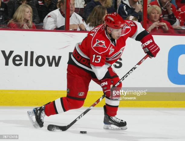 Ray Whitney of the Carolina Hurricanesprepares to pass the puck against the Boston Bruins during their NHL game on December 28, 2007 at RBC Center in...