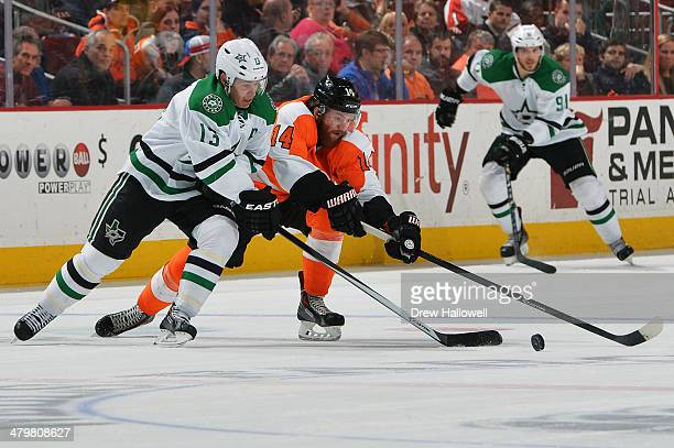 Ray Whitney of the Dallas Stars and Sean Couturier of the Philadelphia Flyers reach for the puck at the Wells Fargo Center on March 20 2014 in...
