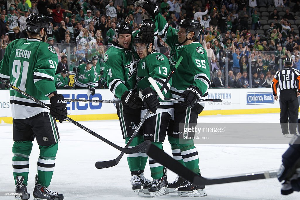 Ray Whitney #13 of the Dallas Stars celebrates his goal with teammates Tyler Seguin #91, Jamie Benn #14 and Sergei Gonchar #55 against the Winnipeg Jets at the American Airlines Center on March 24, 2014 in Dallas, Texas.