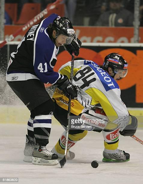 Ray Whitney of the Primus Worldstars stickhandles around Daniel Briere of SC Bern on December 15, 2004 at Bern Arena in Bern Switzerland.