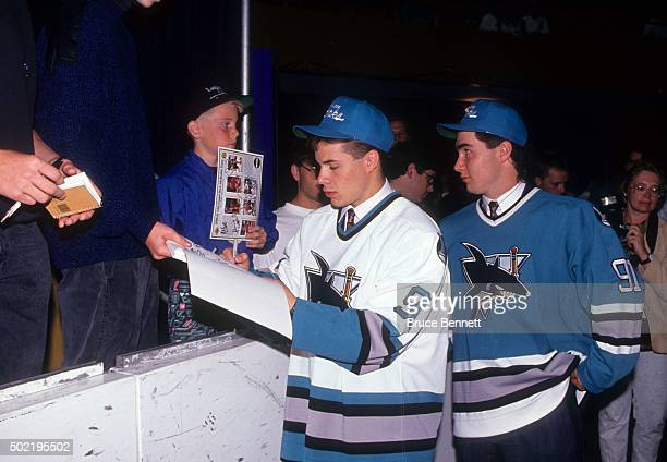 Ray Whitney the 23rd overall pick and Pat Falloon the 2nd overall pick of the San Jose Sharks sign autographs during the 1991 NHL Entry Draft on June...