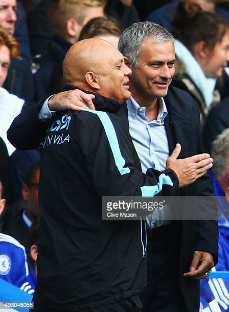 Ray Wilkins Assistant manager of Aston Villa shares a joke with Jose Mourinho manager of Chelsea during the Barclays Premier League match between...