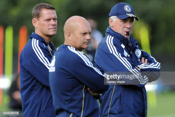 Ray Wilkins, Carlo Ancelotti, Frank Arnesen of Chelsea look on during a training session ahead of their third round Carling Cup match against...