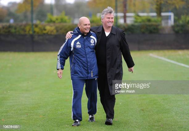 Ray Wilkins of Chelsea with Ex manager Guus Hiddink during a training session at the Cobham Training ground on October 28 2010 in Cobham England
