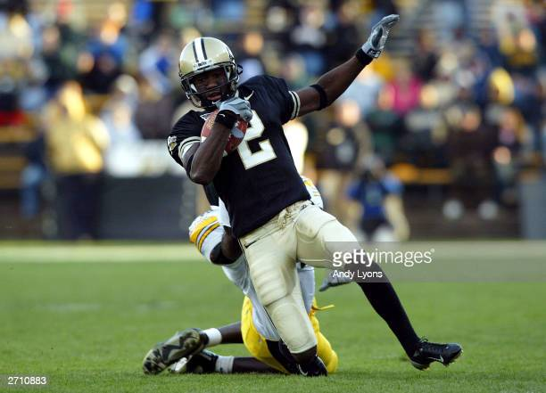 Ray Williams of the Purdue Boilermakers runs with the ball against against the Iowa Hawkeyes November 8 2003 at RossAde Stadium in West Lafayette...