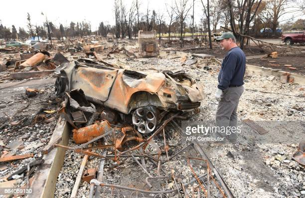 Ray Wilson describes how a neighbour's car that was parked across the street landed in his bedroom during the fire that burned his home in the Coffey...