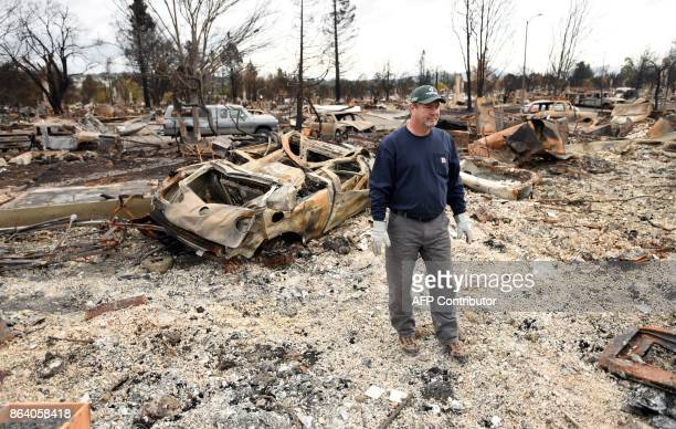 Ray Wilson views his burned home in the Coffey Park area of Santa Rosa California on October 20 2017 Residents are being allowed to return to their...