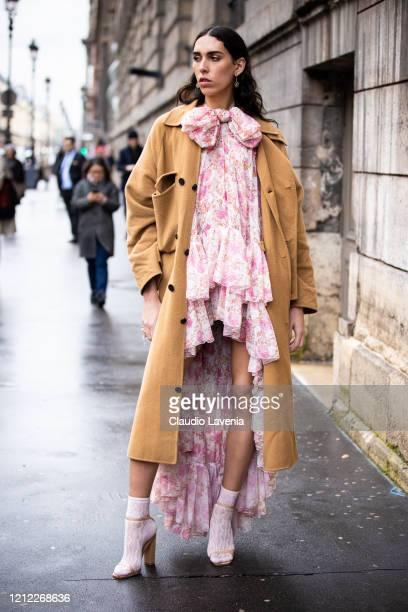 Raya Martigny wearing a pink floral print maxi dress nude heels pink socks and beige coat is seen outside Giambattista Valli during Paris Fashion...