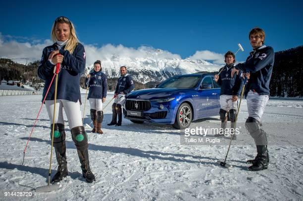 Raya Sidorenko Zhanna Bandurko Hissam al Hyder Robert Strom and Gerardo Mazzini of team Maserati pose near a Maserati Levante during Snow Polo World...