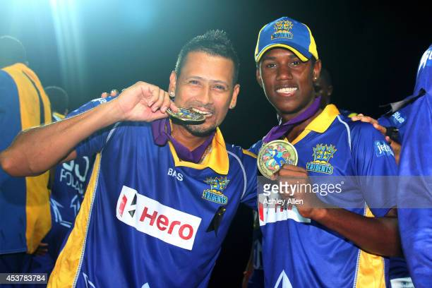 Rayad Emrit and Akeal Hosien of Barbado Tridents pose with their medals after the Limacol Caribbean Premier League 2014 final match between Guyana...