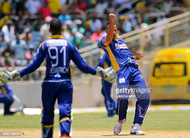 Rayad Emrit of Barbados Tridents celebrates taking 3 Jamaica Tallawahs wickets for 35 runs during a match between Jamaica Tallawahs and Barbados...