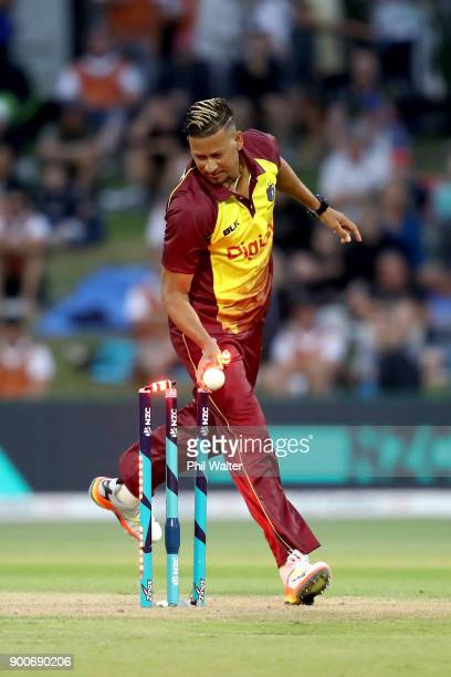 Rayad Emrit of the West Indies runs out Anaru Kitchen of the New Zealand Black Caps during game three of the Twenty20 series between New Zealand and...