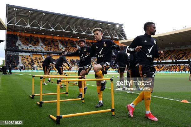 Rayan Ait-Nouri and Adama Traore of Wolverhampton Wanderers warms up prior to the Premier League match between Wolverhampton Wanderers and Manchester...