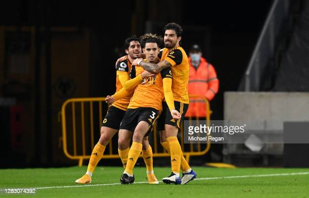 Rayan Ait-Nouri of Wolverhampton Wanderers celebrates with teammates after scoring his team's first goal during the Premier League match between...