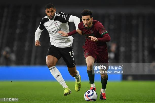 Rayan Ait-Nouri of Wolverhampton Wanderers is challenged by Ruben Loftus-Cheek of Fulham during the Premier League match between Fulham and...