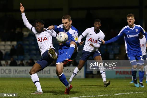 Rayan Clarke of Tottenham Hotspur U21 is tackled by Lee Hodson of Gillingham during the Leasingcom Trophy Southern Group A match between Gillingham...