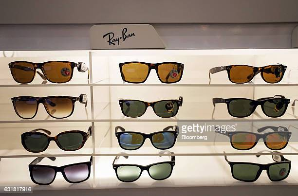 3daf8cfeefa RayBan luxury sunglasses manufactured by Luxottica Group SpA stand on  display in an opticians in London