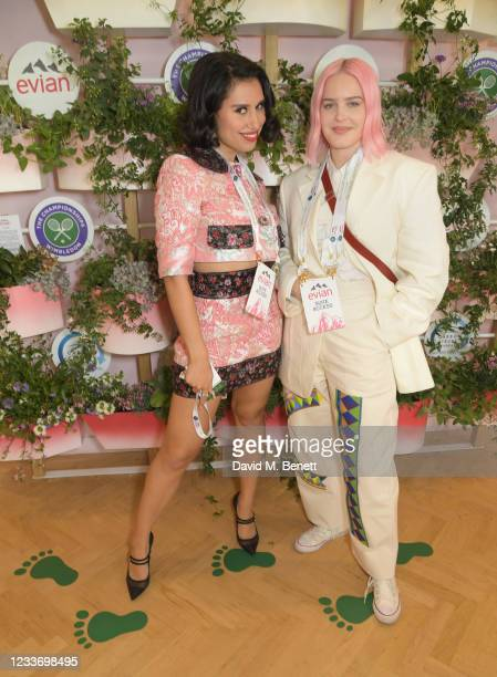Raye and Anne-Marie pose in evian's VIP suite, certified as carbon neutral by The Carbon Trust, during day one of The Championships, Wimbledon 2021...