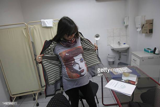 Rayen Luna Solar 33week pregnant is seen by her midwife for a routine checkup in Santiago on July 13 2012 In Chile 38 percent of the births are...