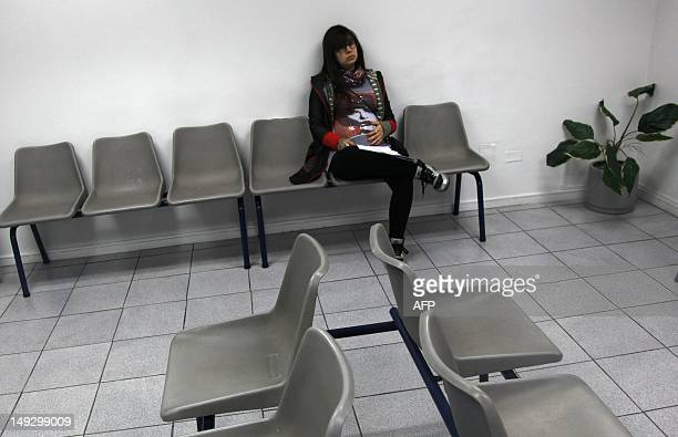 Rayen Luna Solar 33week pregnant waits to be seen by her midwife for a routine checkup in Santiago on July 13 2012 In Chile 38 percent of the births...
