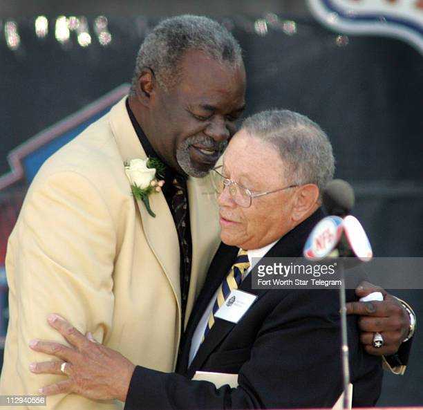 Rayfield Wright left and his presenter LJ Stan Lomax share a hug at the Pro Football Hall of Fame induction ceremony on Saturday August 5 in Canton...