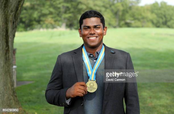 Rayhan Thomas of India and the International team with his medal during the final day singles matches in the 2017 Junior President's Cup at the...