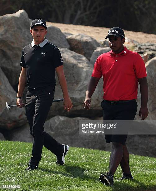 Rayhan Thomas of India pictured with Rickie Fowler of the United States on the 12th hole during a practice round ahead of the Abu Dhabi HSBC...