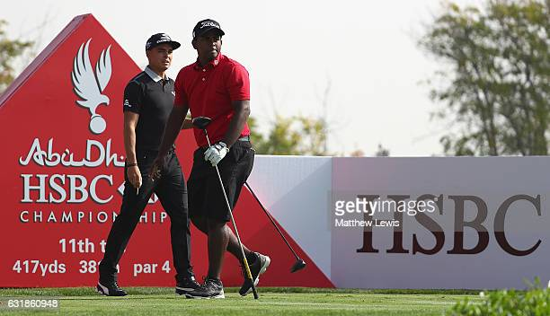 Rayhan Thomas of India pictured with Rickie Fowler of the United States on the 11th hole during a practice round ahead of the Abu Dhabi HSBC...