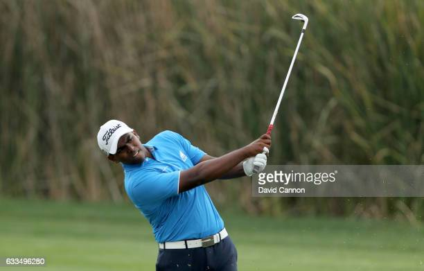 Rayhan Thomas of India plays his second shot on the par 4ninth hole during the first round of the 2017 Omega Dubai Desert Classic on the Majlis...