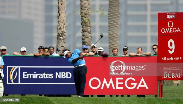 Rayhan Thomas of India plays his tee shot on the par 4 ninth hole during the first round of the 2017 Omega Dubai Desert Classic on the Majlis Course...