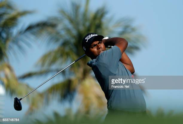 Rayhan Thomas of India tees off on the 13th hole during the completion of the weather delayed second round of the Omega Dubai Desert Classic on the...