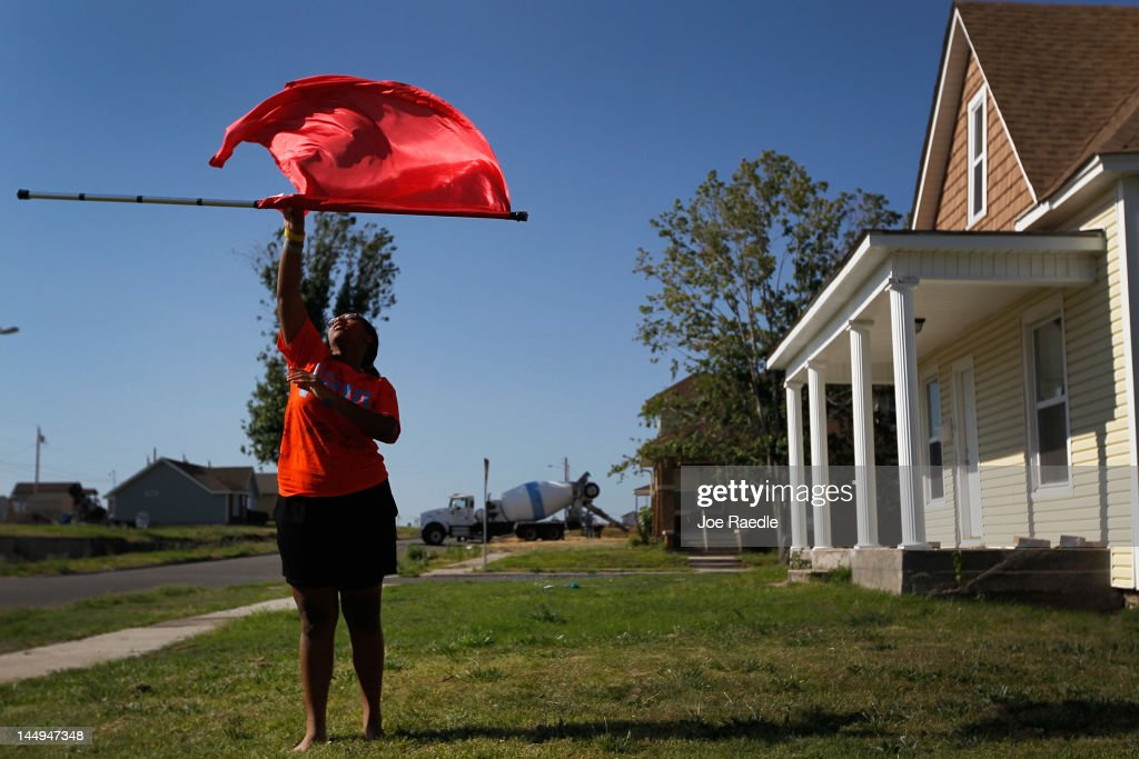 Rayiah Bryant practices on the front lawn of her parent's house for the high school drill team as she prepares to try out for the team next year on May 21, 2012 in Joplin, Missouri. Her parent's house was heavily damaged during the tornado that hit the town but has since been fixed up. Tomorrow will mark the one-year anniversary of the EF-5 tornado that devastated the town. The tornado left behind a path of destruction along with 161 deaths and hundreds of injuries, but one year later there are signs that the town is beginning to recover.