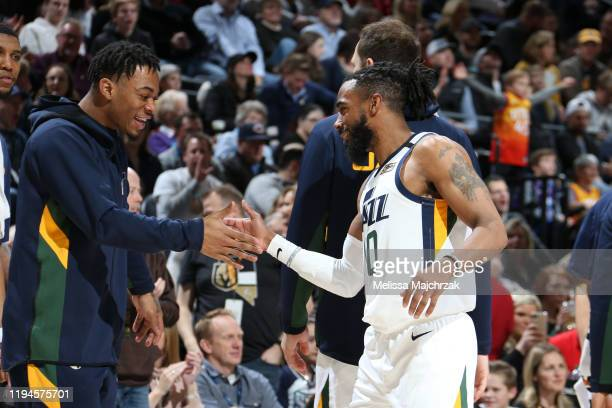 Rayjon Tucker and Mike Conley of the Utah Jazz hifive during the game against the Sacramento Kings on January 18 2020 at vivintSmartHome Arena in...