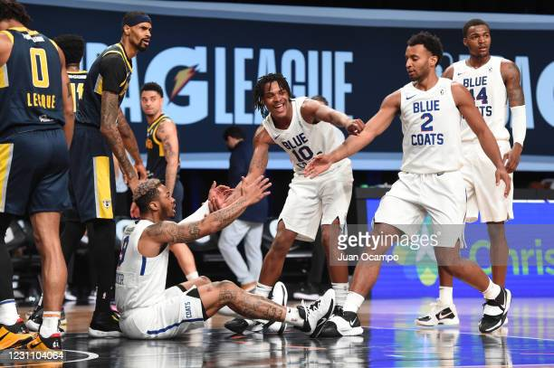 Rayjon Tucker is helped up by Jemerrio Jones and Braxton Key of the Delaware Blue Coats during the game against the Fort Wayne Mad Ants on February...