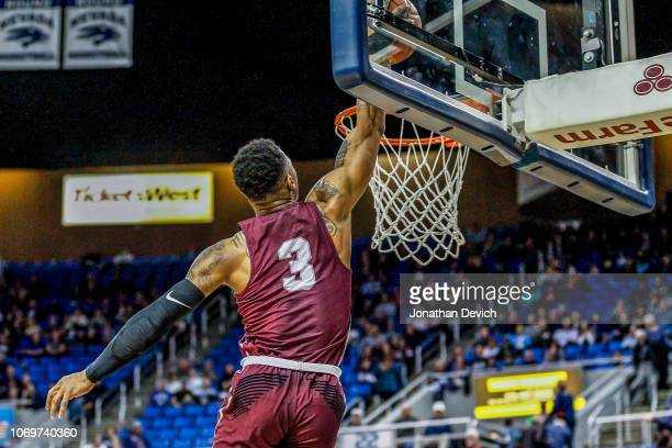 Rayjon Tucker of the Arkansas Little Rock Trojans dunks the ball during the first half of the game between the Nevada Wolf Pack and the Arkansas...