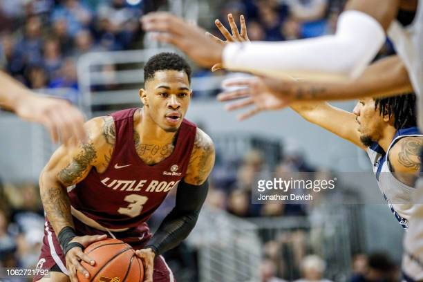 Rayjon Tucker of the Arkansas Little Rock Trojans looks for an opening in the Nevada Wolf Pack defense to pass the ball at Lawlor Events Center on...
