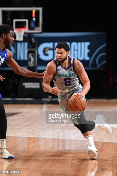 Rayjon Tucker of the Delaware Blue Coats dunks the ball against the Greensboro Swarm on February 16, 2021 at AdventHealth Arena in Orlando, Florida....