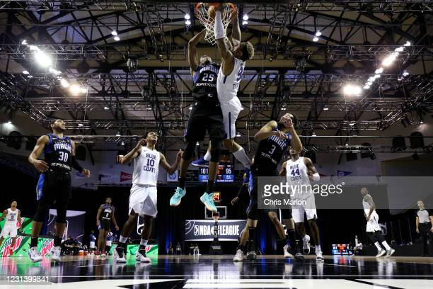 Rayjon Tucker of the Delaware Blue Coats dunks the ball against the Lakeland Magic on February 26, 2021 at HP Field House in Orlando, Florida. NOTE...