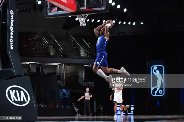 Rayjon Tucker of the Delaware Blue Coats dunks the ball against the Austin Spurs during the NBA G League Playoffs on March 8, 2021 at AdventHealth...
